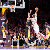 31 October 2014: Los Angeles Clippers forward Blake Griffin (32) goes for the jump shot over Los Angeles Lakers center Robert Sacre (50)  during the Los Angeles Clippers 118-111 victory over the Los Angeles Lakers, at the Staples Center, Los Angeles, California, USA.