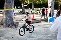 """#121, 5-8 age category.  """"Run, Bike, Swim"""" the Rotary Sunrise Kids Triathalon at Magens Bay.  St. Thomas, USVI.  11 April 2015.  © Aisha-Zakiya Boyd"""