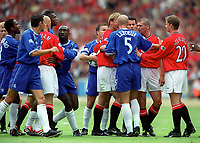 Tempers fray between the two teams after an arguement between Roberto Di Matteo (Chelsea) and Roy Keane (Man Utd). (L>R) Paul Scholes (Utd) Celestine Babayaro, Gustavo Poyet (Chel) David Beckham (Utd) Marcel Desially Jimmy Floyd Hasselbaink Dennis Wise (Chelsea) Teddy Sheringham (Utd) Frank Leboeuf (Chel) Ryan Giggs Roy Keane and Ole Gunnar Solskjaer (Utd). Chelsea v Manchester United. FA Charity Shield. Wembley 13/8/00. Credit: Colorsport.