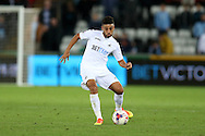 Neil Taylor of Swansea city (c) in action.EFL Cup. 3rd round match, Swansea city v Manchester city at the Liberty Stadium in Swansea, South Wales on Wednesday 21st September 2016.<br /> pic by  Andrew Orchard, Andrew Orchard sports photography.