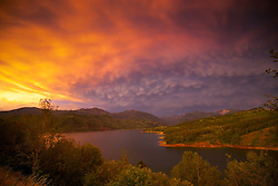 Thunder Storm sunset, mammatus clouds, Palisades Reservoir, Snake River Range, Swan Valley, Idaho