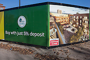 A construction hoarding showing a future estate, on offer for just a 5% deposit, on 28th November 2016, in Camberwell, south London borough of Southwark, England.