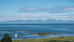 View of The Paps of Jura mountains on the Island of Jura from Kintyre Peninsula in Argyll and Bute , Inner Hebrides,Scotland , United Kingdom