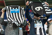Football - 2016 / 2017 Championship - Cardiff City vs. Newcastle United<br /> <br /> Newcastle fans wave a shirt with the logo 'wonga' prominent  after the end of their victory , at Cardiff City Stadium.<br /> <br /> COLORSPORT/WINSTON BYNORTH