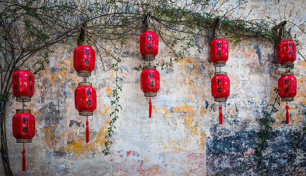 """Hongcun (Chinese: 宏村; pinyin: Hóngcūn; literally: """"Hong village"""") is a village in Hongcun Town (宏村镇), Yi County, Huangshan City in the historical Huizhou region of southern Anhui Province, China, near the southwest slope of Mount Huangshan.<br /> <br /> The village is arranged in the shape of an ox with the nearby hill (Leigang Hill) interpreted as the head, and two trees standing on it as the horns. Four bridges across the Jiyin stream can be seen as the legs whilst the houses of the village form the body. Inside the """"body"""", the Jiyin stream represents the intestines and various lakes such as the """"South Lake"""" (Nanhu) form the other internal organs.<br /> <br /> The architecture and carvings of the approximately 150 residences dating back to the Ming and Qing Dynasties are said to be among the best of their kind in China.[citation needed] One of the biggest of the residences open to visitors, Chenzhi Hall, also contains a small museum.<br /> <br /> Together with Xidi, the village became a UNESCO World Heritage Site in 2000. Scenes from the film Crouching Tiger, Hidden Dragon were filmed on location in Hongcun."""