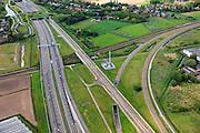 """Nederland, Noord-Brabant, Breda, 09-05-2013; infrabundel, combinatie van autosnelweg A16 gebundeld met de spoorlijn van de HSL (re). Kruising met spoorlijn naar Roosendaal, rechtsonder verbindingsbogen tussen HSL en reguliere spoorlijn (voor shuttle treinen en Fyra richting Antwerpen). <br /> De bundel loopt in tunnelbakken, lokale wegen gaan over deze infrabundel heen, door middel van de zogenaamde stadsducten, gedeeltelijk ingericht als stadspark. <br /> Combination of motorway A16 and the HST railroad, crossed by common railroads and local roads, partly designed as """"urban ducts"""". <br />  <br /> luchtfoto (toeslag op standard tarieven);<br /> aerial photo (additional fee required);<br /> copyright foto/photo Siebe Swart."""