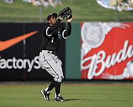 TEMPE, AZ - MARCH 4:  Juan Pierre #1 of the Chicago White Sox fields against the Los Angeles Angels on March 4, 2010 at Tempe Diablo Stadium in Tempe, Arizona. (Photo by Ron Vesely)