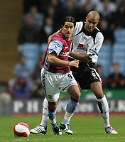 Photo: Lee Earle.<br /> Aston Villa v Fulham. The Barclays Premiership. 21/10/2006. Villa's Juan Pablo Angel (L) battles with Zat Knight.