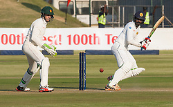 Sri Lanka batsman Upul Tharanga in action as wicket keeper Peter Moor looks on during the 100th test match played by Zimbabwe in a match with Sri Lanka at Harare Sports Club 29 October 2016.