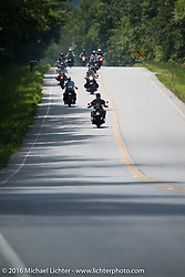 Bikers out riding unaware of the 100 antiques about to ride past them during Stage 3 of the Motorcycle Cannonball Cross-Country Endurance Run, which on this day ran from Columbus, GA to Chatanooga, TN., USA. Sunday, September 7, 2014.  Photography ©2014 Michael Lichter.
