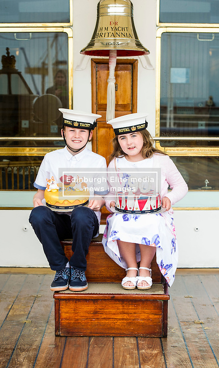 """Pictured: Lucy Kearney (8) and Alfie Bennet (11)<br /> <br /> Chefs Tom Kitchin and Vicki Tighe presented primary pupils Alfie Bennet and Lucy Kearney with nine-inch versions of their winning entries for the """"Design a Cake for The Queen's 90th Birthday"""" competition on the Royal Yacht Britannia today. <br /> Ger Harley   EEm 10 June 2016"""