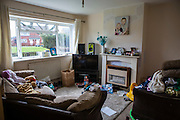 The family living room of a council house on an estate in Leyland, Lancashire.