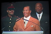 Minister Louis Farrakhan, Nation of Islam, during a live TV link up from Chicago USA for his Saviours' Day address, the minister is banned from entering the UK. The Nation of Islam held the event at Broadwater Farm estate community centre in Tottenham, London.