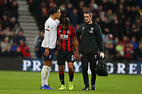 Football - 2019 / 2020 Premier League - AFC Bournemouth vs. Liverpool<br /> <br /> Bournemouth's Nathan Ake limps off and receives a pat on the head from fellow countryman Virgil van Dijk of Liverpool at the Vitality Stadium (Dean Court) Bournemouth <br /> <br /> COLORSPORT/SHAUN BOGGUST