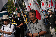 Japanese police in riot gear guard right wingers marching during the commemoration of the end of the Pacific war at Yasukuni Shrine, Kudanshita, Tokyo, Japan. August 15th 2010