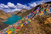 Prayer flags on a hill above Manla Reservoir, near Gyangze, Tibet (Xizang), China.