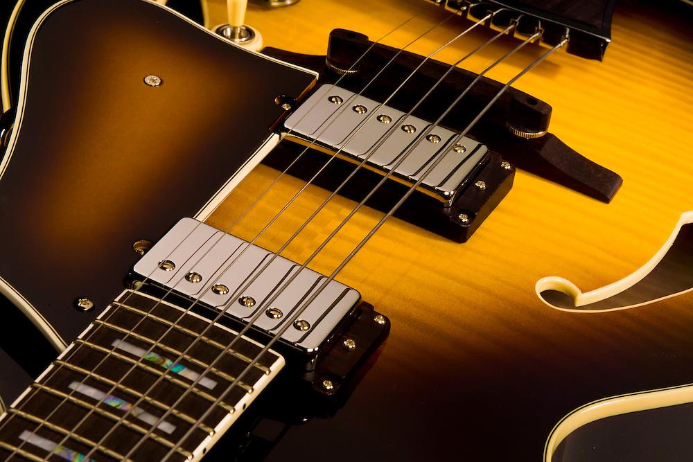 Ibanez Artcore guitar detail of pickups. Two toned,  natural wood grain guitar