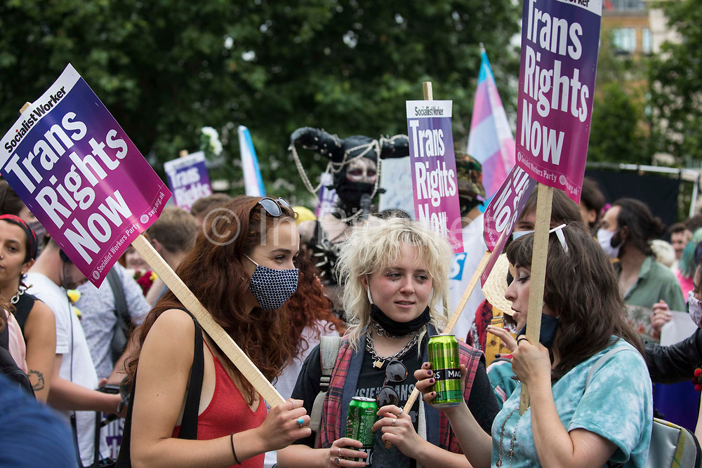 Thousands of people assemble to take part in a London Trans+ Pride march from the Wellington Arch to Soho Square on 26th June 2021 in London, United Kingdom. London Trans+ Pride is a grassroots protest event which is not affiliated with Pride in London and focuses on creating a space for the London trans, non-binary, intersex and GNC community to come together to celebrate their identities and to fight for their rights.