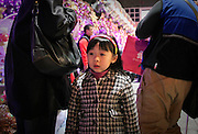 A girl in a holiday fair crowd