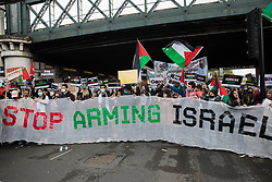 London, UK. 22nd May, 2021. Activists march behind a Stop Arming Israel banner during the National Demonstration for Palestine. It was organised by pro-Palestinian solidarity groups in protest against Israel's recent attacks on Gaza, its incursions at the Al-Aqsa mosque and its attempts to forcibly displace Palestinian families from the Sheikh Jarrah neighbourhood of East Jerusalem.
