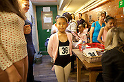"""Mcc0035274 . Daily Telegraph..Queueing for registration...Audition's for the London Children's Ballet in Fulham today and a chance for a role in a production of """"The Little Princess"""" at the Peacock Theatre in April 2012..In the nine year olds age group pictured here there were 100 auditionees for a mere 7 places...London 30 October 2011."""