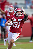 FAYETTEVILLE, AR - OCTOBER 17:    Grant Morgan #31 of the Arkansas Razorbacks celebrates after returning an interception for a touchdown during a game against the Mississippi Rebels at Razorback Stadium on October 17, 2020 in Fayetteville, Arkansas.  The Razorbacks defeated the Rebels 33-21.  (Photo by Wesley Hitt/Getty Images) *** Local Caption *** Grant Morgan
