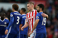 Diego Costa of Chelsea ® and Ryan Shawcross of Stoke city show a mutual respect as they embrace at the end of the game. Premier league match, Stoke City v Chelsea at the Bet365 Stadium in Stoke on Trent, Staffs on Saturday 18th March 2017.<br /> pic by Andrew Orchard, Andrew Orchard sports photography.