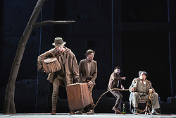 "© Licensed to London News Pictures. 05/06/2015. London, UK. L-R: Luke Mullins as Lucky, Richard Roxburgh as Estragon, Hugo Weaving as Vladimir and Philip Quast as Pozzo. Actors Richard Roxburgh and Hugo Weaving star in Samuel Beckett's ""Waiting for Godot"" at the Barbican Theatre. Part of the International Beckett Season, this Sydney Theatre Company play is directed by Andrew Upton. With Luke Mullins as Luke, Philip Quast as Pozzo, Richard Roxburgh as Estragon and Hugo Weaving as Vladimir. Performances from 4 to 13 June 2015 at the Barbican Theatre. Photo credit : Bettina Strenske/LNP"