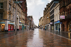 Glasgow, Scotland, UK. 5 January 2020. Views of a very quiet Glasgow City Centre as Scotland wakes up to the first day of a new strict national lockdown announced by Scottish Government to contain new upsurge in Covid-19 infections. Pic; Buchanan Street is normally busy with shoppers but today is almost deserted.  Iain Masterton/Alamy Live News