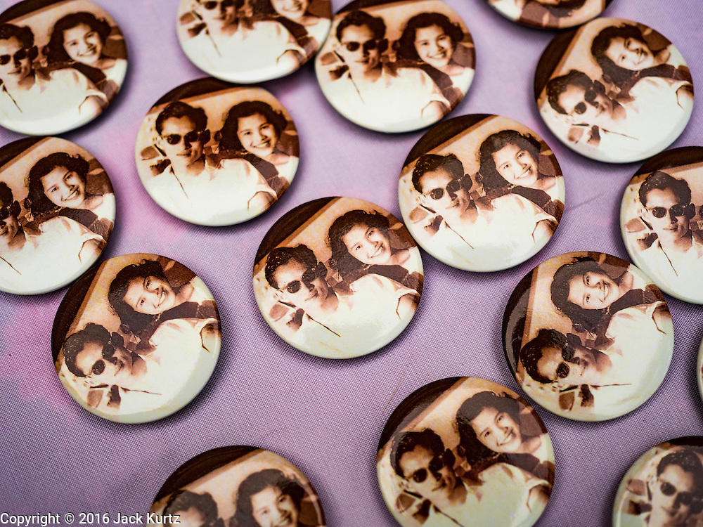 17 OCTOBER 2016 - BANGKOK, THAILAND: Pins with portraits of Bhumibol Adulyadej, the late King of Thailand, for sale near Sanam Luang in central Bangkok. Thai King Bhumibol Adulyadej died Oct. 13, 2016. He was 88. His death comes after a period of failing health. Bhumibol Adulyadej, was born in Cambridge, MA, on 5 December 1927. He was the ninth monarch of Thailand from the Chakri Dynasty and is also known as Rama IX. He became King on June 9, 1946 and served as King of Thailand for 70 years, 126 days. He was, at the time of his death, the world's longest-serving head of state and the longest-reigning monarch in Thai history.        PHOTO BY JACK KURTZ