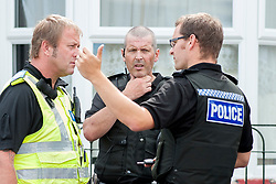 South Yorkshire Police NE Sheffield Safer Neighburhoods Team working in the Page Hall area of Sheffield Inspector Simon Leake discusses a recent arrest with fellow officers<br /> <br /> <br /> 15 August 2013<br /> Image © Paul David Drabble<br /> www.pauldaviddrabble.co.uk
