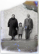 parents with child on broken and severely eroding glass plate