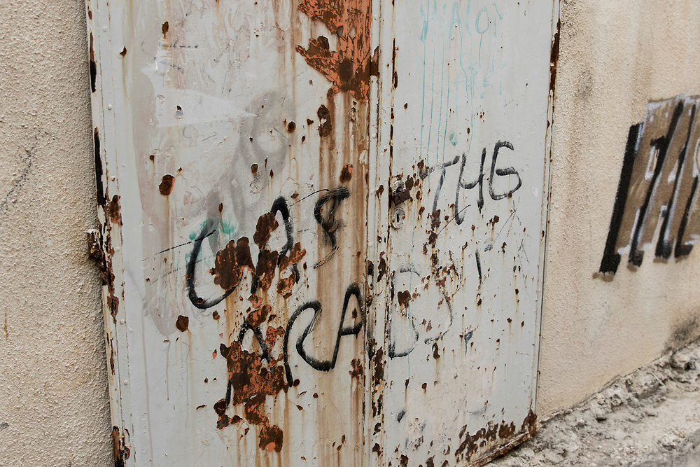 'Gas the Arabs' is seen painted on a wall outside a Palestinian's home