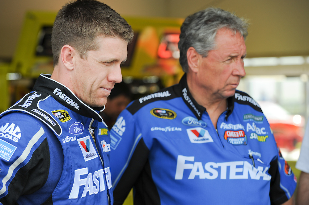 Feb 22, 2013; Daytona Beach, FL, USA; Sprint Cup Series driver Carl Edwards, left, and his crew chief, Jimmy Fennig, during practice for the the Daytona 500 at Daytona International Speedway. Photo by Kevin Liles/kevindliles.com