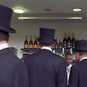 Race goers queue for champagne during the races at Royal Ascot Race Course. Royal Ascot is one of the most famous race meetings in the world, frequented by Royalty and punters from the high end of society to the normal everyday working class. Royal Ascot 2009, Ascot, UK, on Wednesday, June 17, 2009. Photo Tim Clayton..