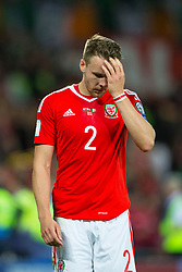 CARDIFF, WALES - Monday, October 9, 2017: Wales' Chris Gunter looks dejected after the final whistle in the 2018 FIFA World Cup Qualifying Group D match between Wales and Republic of Ireland at the Cardiff City Stadium. (Pic by Paul Greenwood/Propaganda)