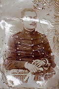 deteriorated image of a French army officer studio portrait 1900s