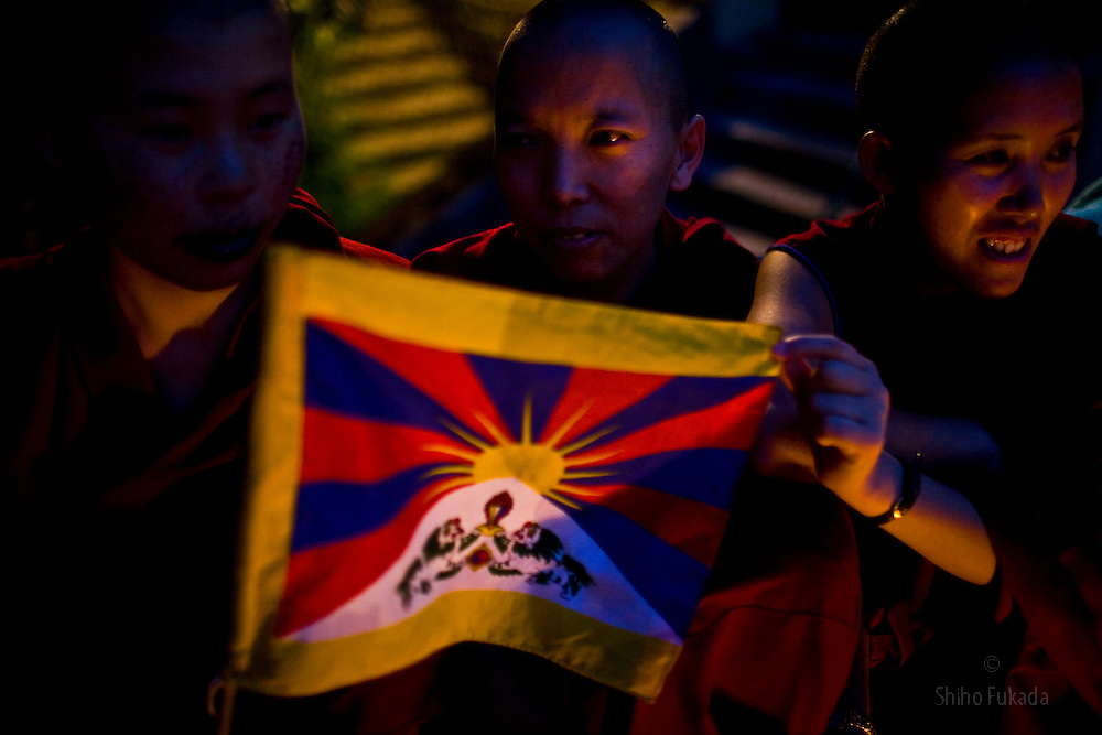INDIA - Life in Exile (Tibetan Refugees) <br /> Tibetan nuns hold a flag of Tibet which is banned in China during a candle light vigil for the 20th anniversary of Tianmen Square protest in McLeod Ganj, Dharamsala, India, where the Dalai Lama settled after fleeing Tibet in 1959 after a failed uprising against Chinese rule, June  3, 2009.