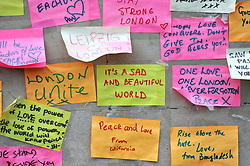 Messages of support left on the base of the obelisk on London Bridge, after an unknown 21 year-old man left a box of tape, sticky notes and marker pens with an invite to write a message, following the terror attack in which eight people died.
