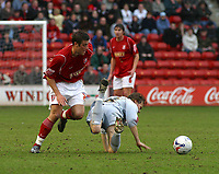 Photo: Dave Linney.<br />Walsall v Bradford City. Coca Cola League 1. 25/03/2006.<br />Walsall's Michael Leary (L) sends Tom Penford flying