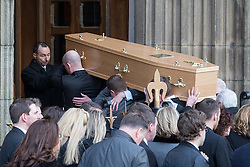 © Licensed to London News Pictures . 16/01/2014 . Salford , UK . The coffin is carried in to the cathedral . The funeral of Labour MP Paul Goggins at Salford Cathedral today (Thursday 16th January 2014) . The MP for Wythenshawe and Sale East died aged 60 on 7th January 2014 after collapsing whilst out running on 30th December 2013 . Photo credit : Joel Goodman/LNP