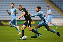 Coventry City's Tony Andreu and Portsmouth's Matthew Clarke battle for the ball
