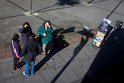Aerial view of women and a mobile rack of Jehova's Witness pamphlets in London borough of Lambeth.