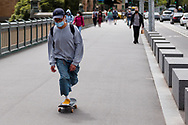 A man rides a skateboard across The Yarra during the COVID-19 in Melbourne. With over a week of zero cases in Victoria, Premier Daniel Andrews is expected to make major announcements on Sunday about further easing of restrictions. (Photo by Dave Hewison/Speed Media)