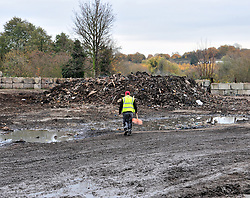 © Licensed to London News Pictures.18/11/2017.<br /> Orpington, UK.<br /> A workman walking towards the last 27 tons of waste.<br /> The infamous Waste4fuel rubbish site in Orpington is due to be totally clear of waste on Monday. Work began to clear the site from 27.000 tons of waste a year ago at Cornwall Drive, Now the site has about 27 tons of rubbish left to clear. Altogether the clearance cost of the waste mountain has come to around £4.5 million with most of the money coming from government and the Enviroment Agency.<br /> Photo credit: Grant Falvey/LNP