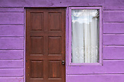 Colorful purple facade of a typical Jamaican house, Jamaica.