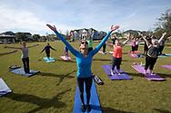 Residents take part in a community-wide yoga class in the Laureate Park neighborhood of the Lake Nona development in Orlando, Fla., Saturday, Jan. 30, 2016. (Phelan M. Ebenhack via AP)