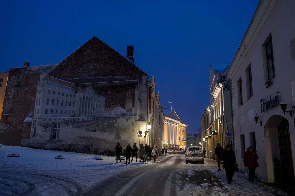 Tartu, Estonia - February 27, 2020:A winter night with snow at the intersection of Ülikooli and Lossi in Tartu, Estonia.