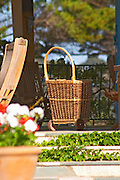 A wicker shopping cart on the terrace before going to the market to buy food. Clos des Iles Le Brusc Six Fours Cote d'Azur Var France