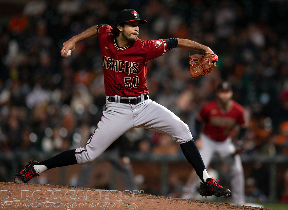 Sep 29, 2021; San Francisco, California, USA; Arizona Diamondbacks pitcher Noé Ramirez (50) delivers a pitch against the San Francisco Giants during the seventh inning at Oracle Park. Mandatory Credit: D. Ross Cameron-USA TODAY Sports